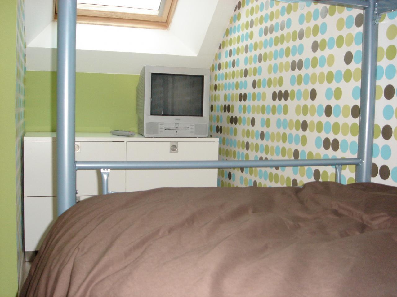 Chambre à l'étage lits superposés